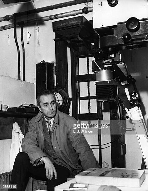 Italian film director Michelangelo Antonioni in London for the filming of 'Blow Up' visits the darkrooms of a Fleet Street photographic press agency