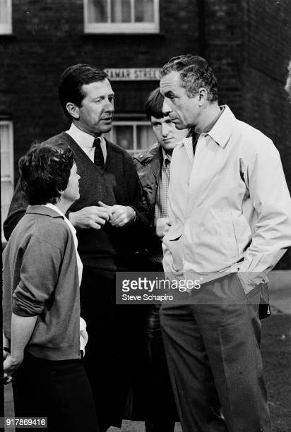 Italian film director Michelangelo Antonioni speaks with unidentified crew members of the set of their film 'BlowUp' London England 1965