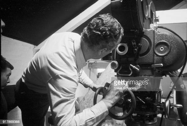 Italian film director Michelangelo Antonioni stands behind the camera on the set of his film 'BlowUp' London England 1965