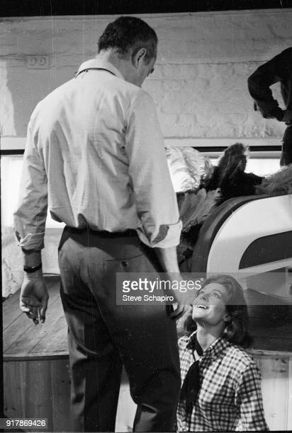 Italian film director Michelangelo Antonioni talks with English actress Vanessa Redgrave on the set of their film 'BlowUp' London England 1965