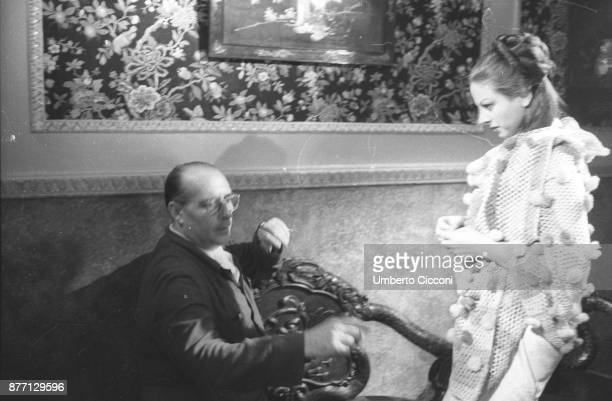 Italian film director Roberto Rossellini directing actress Sandra Milo during the movie 'General della Rovere' 1959
