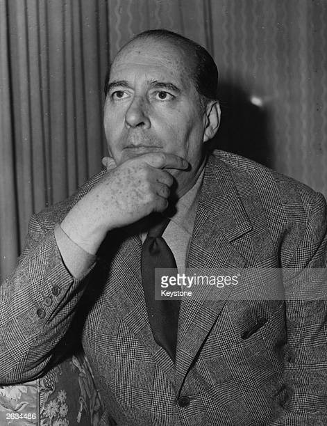 Italian film director Roberto Rossellini in London looking for an English actor to play in a film about a wartime prison camp