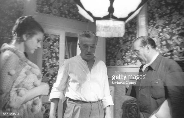 Italian film director Roberto Rossellini with Vittorio De Sica and Sandra Milo during the movie 'General della Rovere' 1959