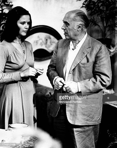 Italian film producer Carlo Ponti talking to Italian actress Agostina Belli in The Governess Rome 1974