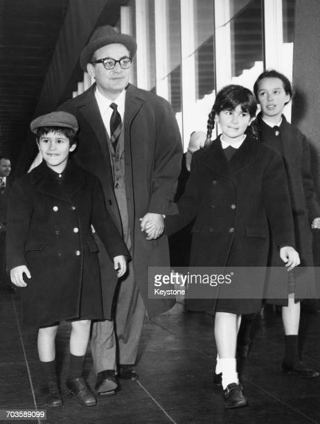 Italian film producer Dino De Laurentiis is met by his children Federico Raffaella and Veronica on his arrival in Rome after a trip to Japan 12th...