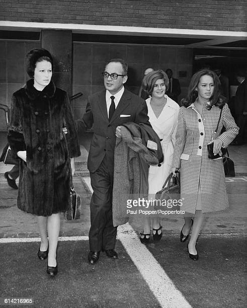 Italian film producer Dino De Laurentiis pictured with his wife actress Silvana Mangano and their daughters Raffaella de Laurentiis and Veronica De...