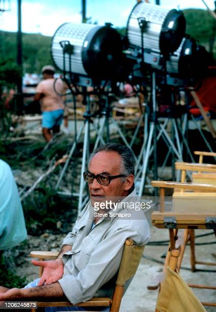 Italian film producer Dino De Laurentiis sits in a director's chair during the filming of 'Hurricane' Bora Bora Leeward Islands French Polynesia 1978
