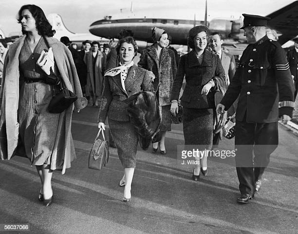 Italian film stars arriving at London Airport for the Italian Film Festival 21st October 1954 From left to right Marisa Belli Irene Genna Gina Maria...