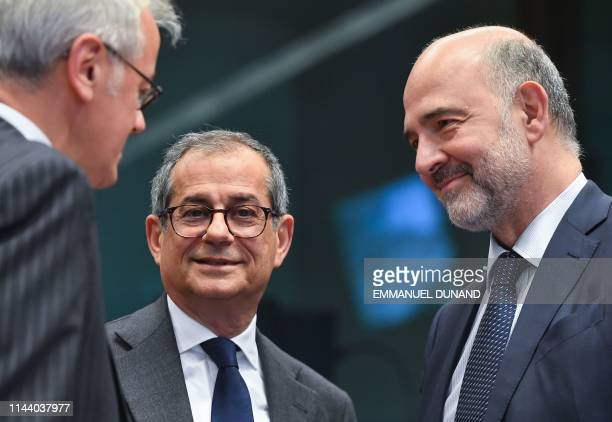 Italian Finance Minister Giovanni Tria and European Commissioner for Economic and Financial Affairs Taxation and Customs Pierre Moscovici attend an...