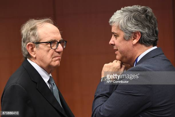 Italian Finance Minister Pier Carlo Padoan and Portugal's Finance Minister Mario Centeno attend an Eurogroup ministerial meeting at the European...