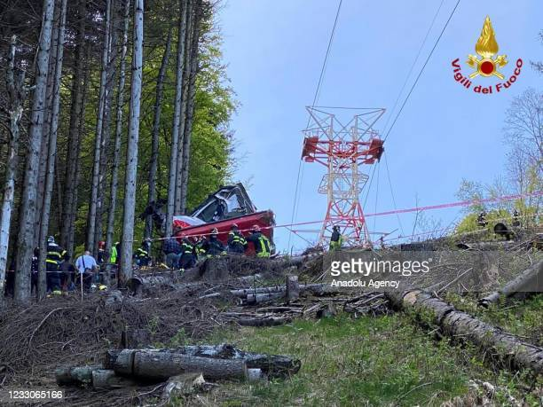 Italian fire fighters are seen near the crashed cable car after it fell from the Stresa-Alpine-Mottarone line near Lake Maggiore in Stresa, Italy on...