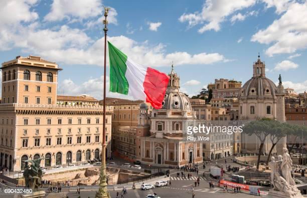 Italian Flag flying over the city of Rome.