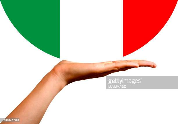 Italian flag in a hemisphere, on an open hand.