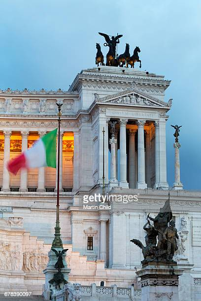 Italian flag in front of the Victor Emmanuel Monument at night, Rome, Lazio, Italy, Europe