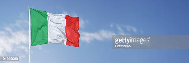 italian flag over blue sky - italian flag stock pictures, royalty-free photos & images