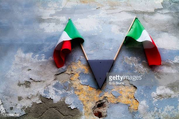 Italian flags hung on old textured wall