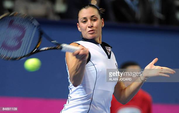 Italian Flavia Pennetta returns the ball to her French opponent Alizee Cornet on the second day of the first round of the 2009 Fed Cup World group...
