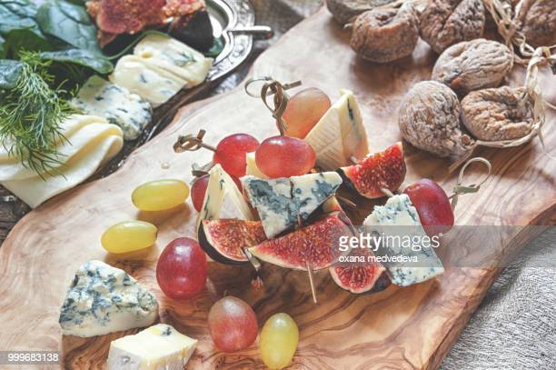 Italian Focaccia bread with cheese and a cheese plate with figs and Gorgonzola, brie, DorBlu and...