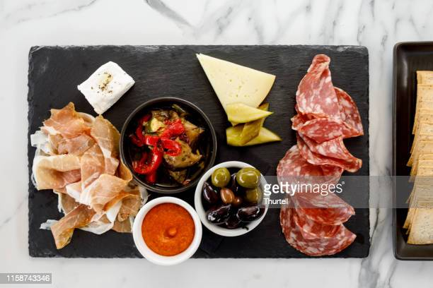 italian food - sopressa and prosciutto platter - antipasto stock pictures, royalty-free photos & images