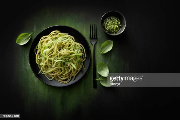 italian food: spaghetti pesto with zucchini still life - pasta stock pictures, royalty-free photos & images