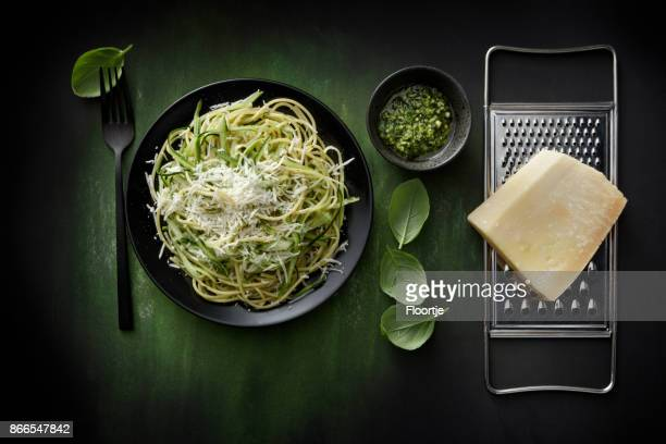 italian food: spaghetti pesto with zucchini still life - parmesan cheese stock pictures, royalty-free photos & images