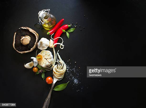 Italian food, spaghetti recipe ingredient on black texture background.