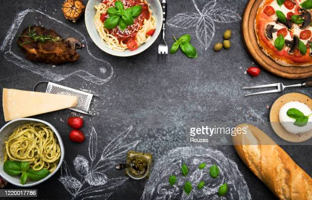italian food with ingredients and copy space - chalk rock stock pictures, royalty-free photos & images