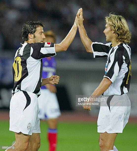 Italian football club team Juventus' captain and forward player Alessandro Del Piero celebrates with teammate midfielder Pavel Nedved after a goal...
