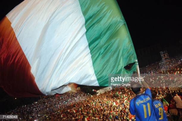 Italian football fans at the Circo Massimo celebrating Italy's victory over France on July 09, 2006 in Rome, Italy. Italy defeated France 5-3 at the...