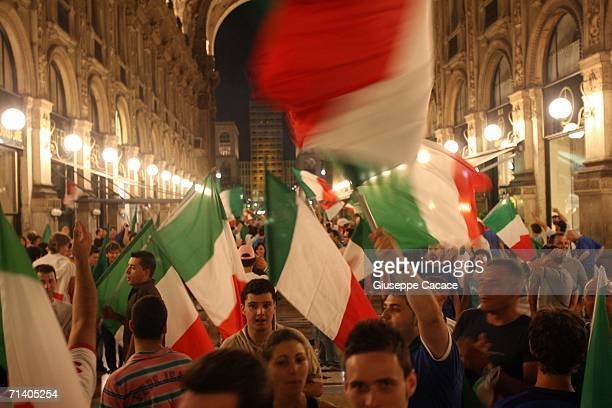 """Italian football fans celebrate Italy's victory at the World Cup 2006 finals in """"Galleria Vittorio Emanuele"""" on July 9, 2006 in Milan, Italy. Italy..."""