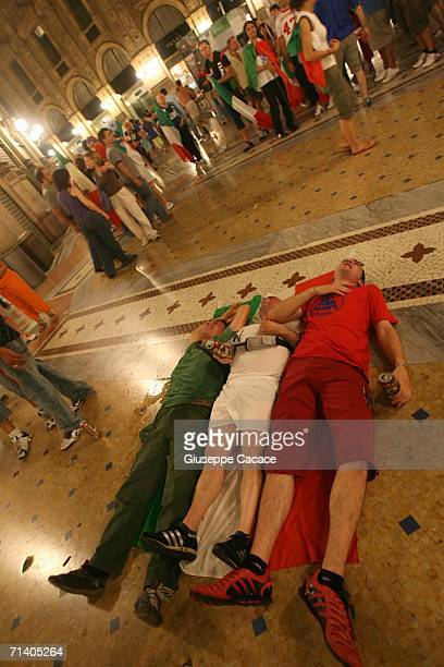 """Italian football fans celebrate Italy's victory at the World Cup 2006 finals in """"Galleria Vittorio Emanuele """" on July 9, 2006 in Milan, Italy. Italy..."""