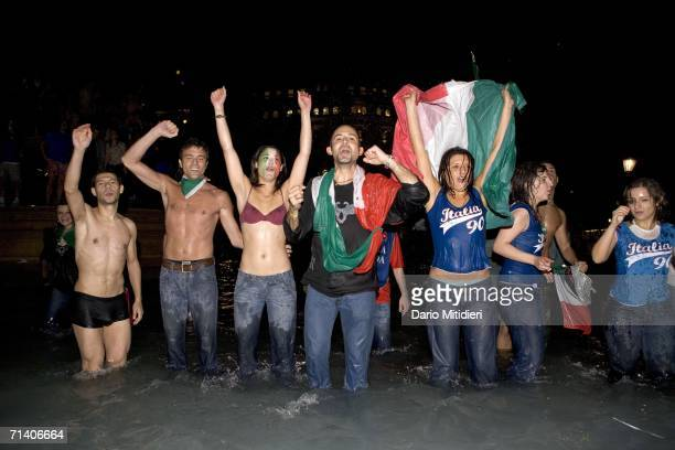 Italian football fans celebrate Italy's victory over France in the World Cup Final in Trafalgar Square on July 9 2006 in London England
