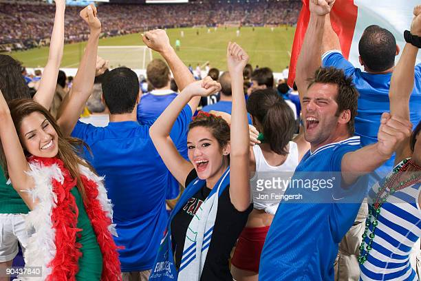 italian football fans cheering - サッカー国際大会 ストックフォトと画像