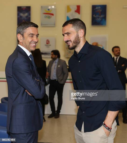 Italian football federation Vice Commissioner Alessandro Costacurta speaks with AC Milan player Leonardo Bonucci during the FIGC meeting at Italian...