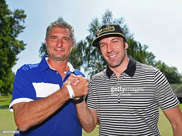 Italian football legends Daniel Massaro and Alessandro del Piero shake hands before the Pro Am of the 71st Italian Open Damiani at Circolo Golf...