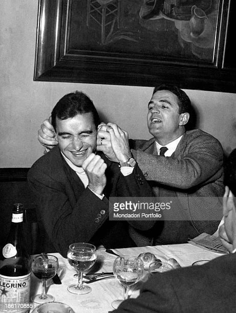 Italian football player Carlo Galli pulling Italian halfback Rino Ferrario's ears 1950s
