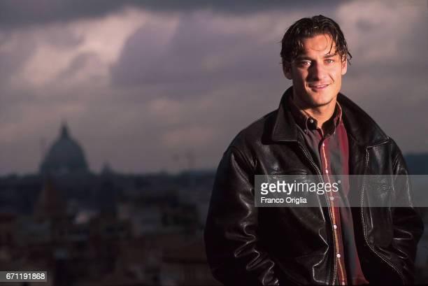 Italian football player Francesco Totti poses for La Gazzetta dello Sport Magazine portrait session at the Giardino degli Aranci on the background St...