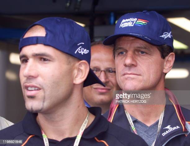 Italian football player Luigi Di Biagio and former Milan AC coach Fabio Capello visit BenettonPlaylife's pits in Spielberg 23 July 1999 two days...