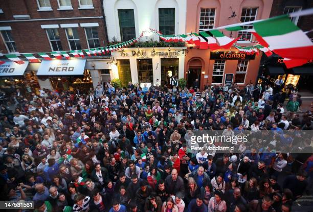 Italian football supporters stand outside Bar Italia to watch the screening of the UEFA EURO 2012 final football match between Spain and Italy,...