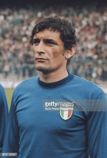 Italian footballer and forward with Cagliari Luigi Riva lines up prior to playing for the Italy national football team in an international match in...