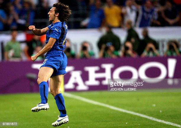 Italian footballer Andrea Pirlo leaps into the air as he celebrates after scoring the opening goal during the FIFA World Cup 2006 group E football...