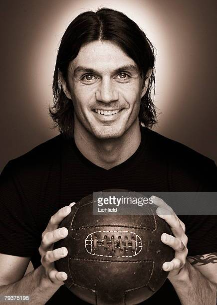 Italian footballer Paolo Maldini son of Cesare Maldini who plays as centre back for AC Milan and his national side holding an old fashioned leather...