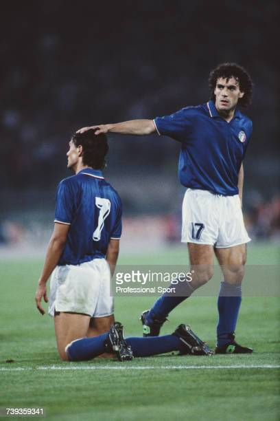 Italian footballer Roberto Donadoni places his hand on the head of team mate Paolo Maldini during the 1990 FIFA World Cup Group A match between Italy...