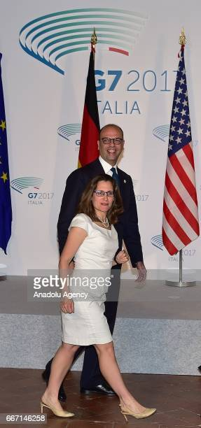 Italian Foreign Minister Angelino Alfano and Canadian Foreign Minister Chrystia Freeland arrive to pose for a photo within the G7 Ministers of...