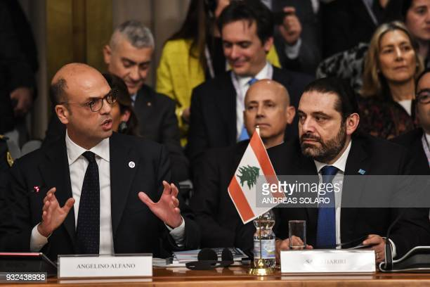 Italian Foreign Minister Angelino Alfano delivers his speech next to Lebanese Prime Minister and Leader of the Future Movement Party Saad Hariri...