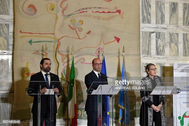 Italian Foreign Minister Angelino Alfano stands along side Lebanese Prime Minister and Leader of the Future Movement Party Saad Hariri and UN Special...