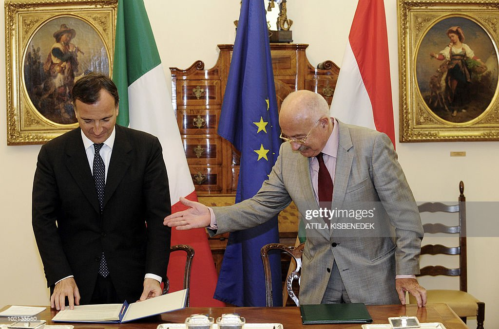 Italian Foreign Minister Franco Frattini (L) is welcomed by his Hungarian counterpart Janos Martonyi (R) during a signing ceremony at the ministry of Foreign Affairs in Budapest on June 16, 2010. Frattini is on a one-day official visit to Hungary.