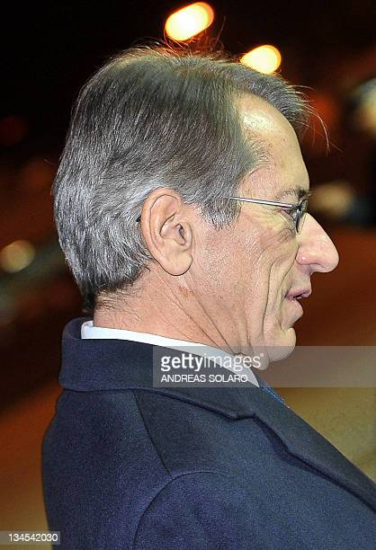 Italian foreign minister Giulio Terzi di Sant'Agata stands upon the arrival of Pope Benedict XVI on November 20 2011 at Ciampino Rome's international...