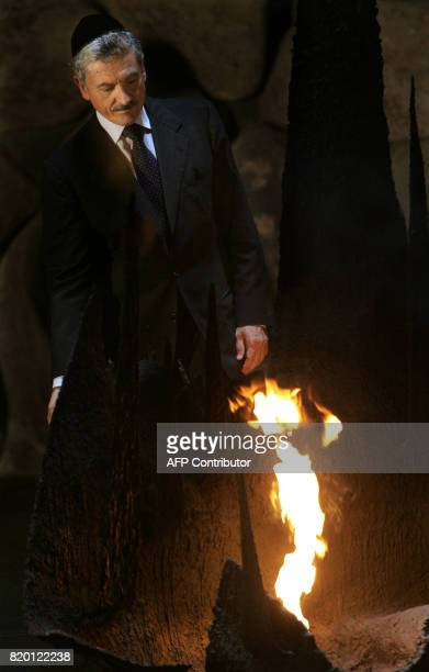 Italian Foreign Minister Massimo D'Alema lights the eternal flame at the Remembrance Hall commemorating Jews who were killed during the Nazi...