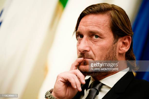 Italian former professional footballer and current technical director at AS Roma, Francesco Totti ponders as he holds a press conference on June 17,...